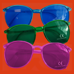 Pair of blue, green, and pink sets of eyeglasses.