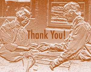 Two men are shaking hands in front of a photocopier to say thank you.
