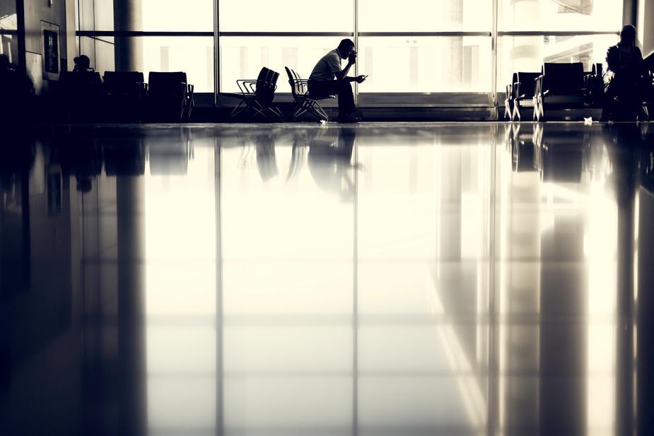 man waiting at airport.