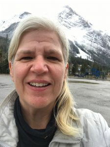 BC Mountains behind me. Photo by Maria Koropecky Ammolite Wellness Coach.